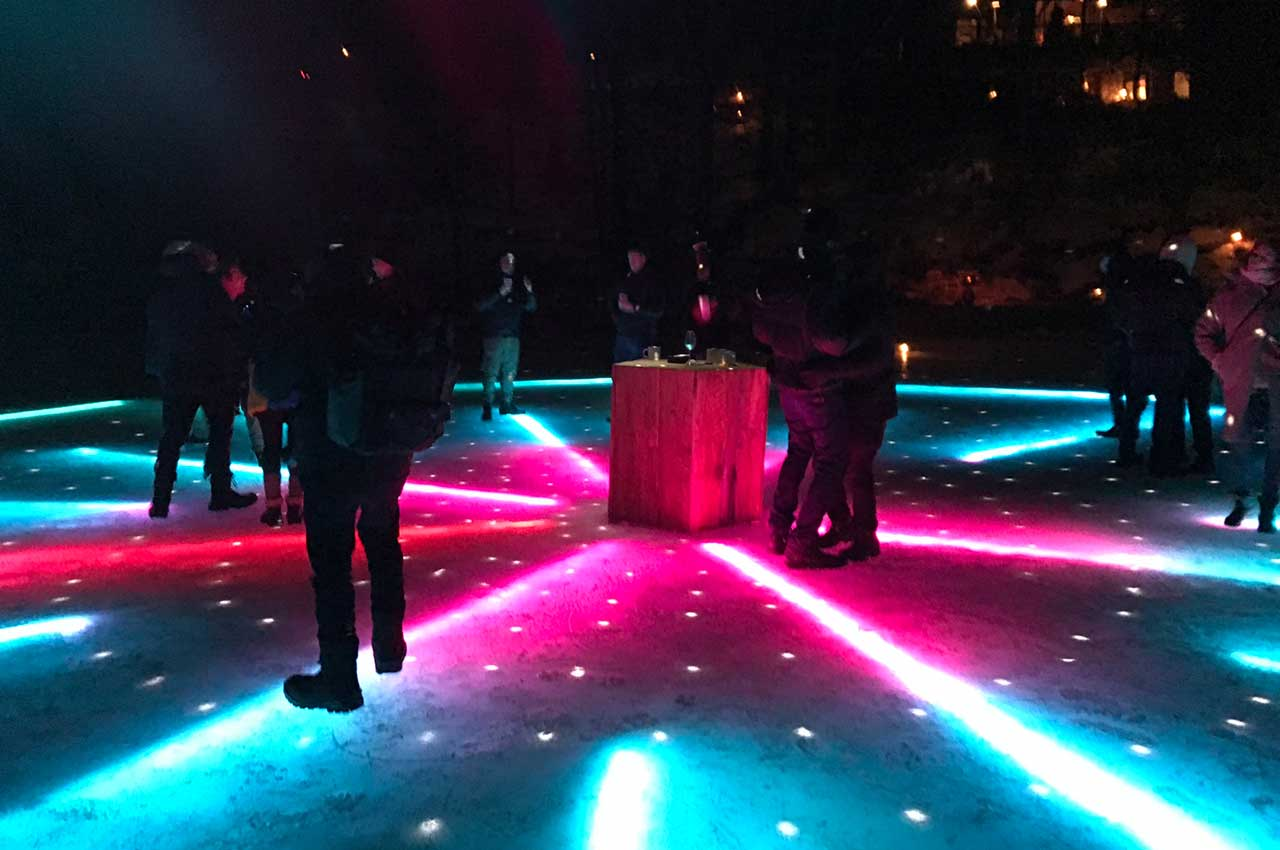 Installed LED dancefloor in ice turned on and with people on it